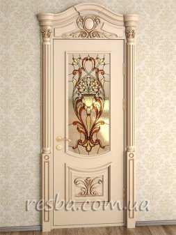Межкомнатная или входная деревянная дверь D3-06-1. Возможно исполнение глухое или со стеклом. В стоимость входит дверное полотно 800х2000мм. из массива ясеня, дверная лутка шириной 100мм., наличники шириной 120мм. на одну сторону, портал резной на одну сторону.