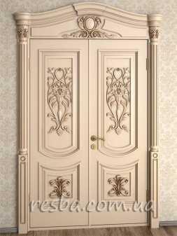 Межкомнатная или входная деревянная дверь D3-06-2. Возможно исполнение глухое или со стеклом. В стоимость входит два дверных полотна 600х2000мм. из массива ясеня, дверная лутка шириной 100мм., наличники шириной 120мм. на одну сторону, резной портал на одну сторону.